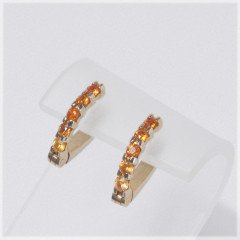 Shared Prong Hinged Earrings With Sapphires